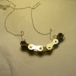 Silver Bike chain pendant (middle part is silver, outer part is regular bike chain)